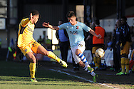 Exeter's Tom Nichols ® goes past Newport's Aaron Holloway.  Skybet football league two match, Newport county v Exeter city at Rodney Parade in Newport, South Wales on Sunday 16th March 2014.<br /> pic by Andrew Orchard, Andrew Orchard sports photography.