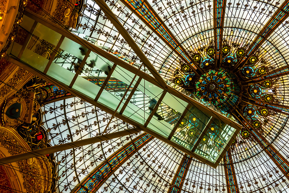 The Glass Walk suspended below the stained glass dome of Galeries Lafayette Paris Haussmann department store, Paris, France.