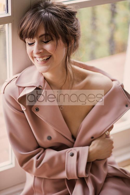 Portrait of Woman Wearing Pink Overcoat Smiling
