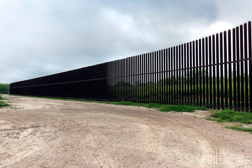 A portion of the high steel border wall, Brownsville, Texas, USA.