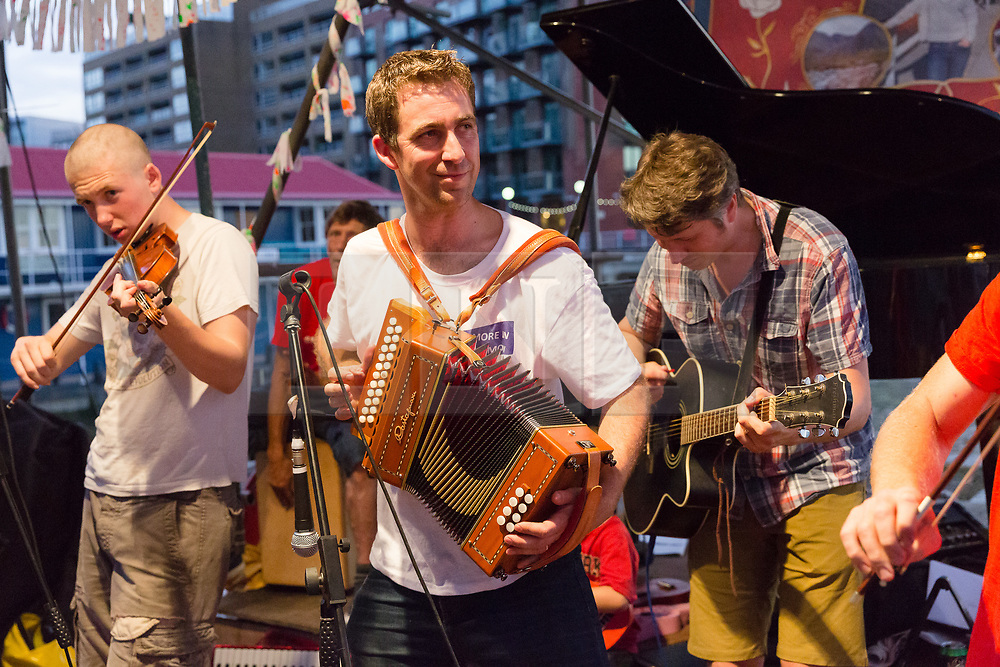 © Licensed to London News Pictures. 18/06/2017. LONDON, UK.  Brendan Cox (centre), husband of murdered MP, Jo Cox plays in his folk band, the Diddly Dee at The Great Get Together at Tower Bridge Moorings in London last night, 17th June 2017. Friends and residents from Hermitage Moornings, where Jo Cox lived on a houseboat with her husband and two children visited residents and friends at Tower Bridge moorings on the River Thames. Photo credit: Vickie Flores/LNP