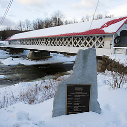 The Ashuelot Covered Bridge spans the Ashuelot River in Winchester, New Hampshire.  Town lattice trust construction.  169 feet long.  Built in 1864.