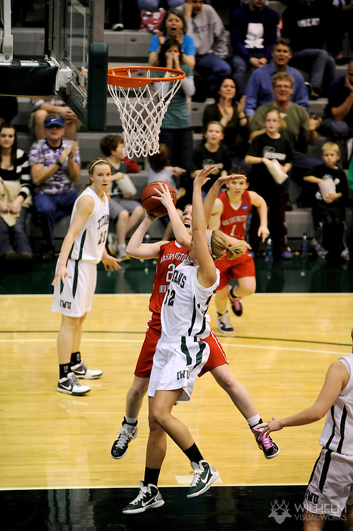 18 MAR 2011:  Alex Hoover (2) of Washington University - St. Louis shoots over Hope Schulte (32) of Illinois Wesleyan University during the 2011 NCAA Women's Division III Basketball Championship held on the campus of the Illinois Wesleyan University in Bloomington, IL. Washington - St. Louis defeated Illinois Wesleyan 87-77 to advance to the final. © Brett Wilhelm