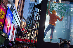 June 3, 2017 - Manhattan, New York, U.S - Geoff Sobelle,performs ''Hose'', during closing night  of ''Holoscenes'', in Times Square. ''Holoscenes'' was inspired by a photograph of the widespread flooding in Pakistan according to artistic director Lars Jan, who began to daydream about ''a man in an aquarium calmly reading a newspaper while flood waters surged around him' (Credit Image: © Nancy Siesel via ZUMA Wire)