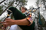 Thomas Nichini of Vancouver plays a bagpiping tune on Monday on the grassy lawn adjacent to North Idaho College beach during the Coeur d'Alene Summer School of Piping and Drumming.