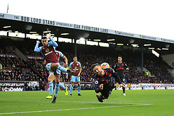 26 November 2017 -  Premier League - Burnley v Arsenal - Matthew Lowton of Burnley clears the ball as Shkodran Mustafi of Arsenal dives in - Photo: Marc Atkins/Offside