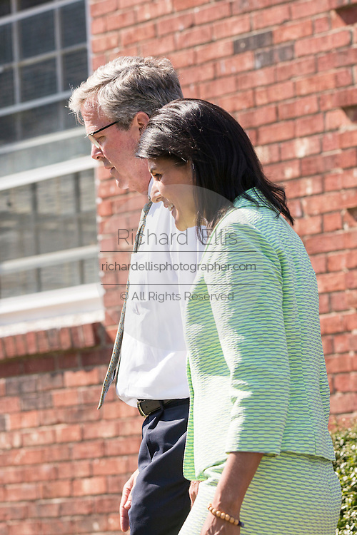 Former Florida Governor and GOP presidential candidate Jeb Bush walks with South Carolina Governor Nikki Haley following a visit to Sistercare March 17 29, 2015 in Columbia, South Carolina. Bush joined Haley in visiting the center for victims of domestic violence.