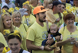 August 27, 2017 - Anaheim, CA, USA - Rhett Butler and his 4-month-old son Waylon, pass the starting line during the 2017 CHOC Walk in Anaheim on Sunday, August  27, 2017. They were part of the Brave Boyle team, a group of 80 walking on behalf of Waylon's cousin. (Credit Image: © Mindy Schauer/The Orange County Register via ZUMA Wire)