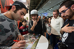 Moto GP rider Danilo Petrucci signing autographs at EICMA, the largest international motorcycle exhibition in the world. Milan, Italy. November 19, 2015.  Photography ©2015 Michael Lichter.