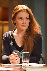 """© Licensed to London News Pictures. 07/04/2014. London, England. Pictured: Actress Olivia Hallinan as Olga. The play """"Three Sisters"""" by Anton Chekhov, in a new version by Anya Reiss, opens at the Southwark Playhouse, London, with Paul McGann as Vershinin, Olivia Hallinan as Olga, Emily Taaffe as Masha and Holliday Grainger as Irina. Directed by Russel Bolam. Photo credit: Bettina Strenske/LNP"""