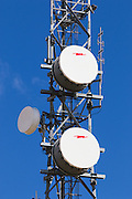 Microwave dish antenna on communications tower for the cellular telephone system. <br /> <br /> Editions:- Open Edition Print / Stock Image