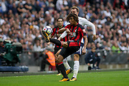 Nathan Ake clears the ball over his head under pressure from Christian Eriksen of Tottenham Hotspur.<br /> Premier league match, Tottenham Hotspur v AFC Bournemouth at Wembley Stadium in London on Saturday 14th October 2017.<br /> pic by Kieran Clarke, Andrew Orchard sports photography.