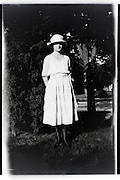 fashionable dressed woman standing in garden 1920s USA