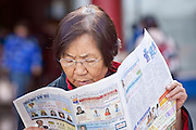 Feb. 8, 2009 -- PHOENIX, AZ: A woman reads a Mandarin language newspaper at the Chinese Cultural Center in Phoenix, AZ. Chinese around the world celebrated the New Year this month. This is the Year of the Ox in the Chinese calender. PHOTO BY JACK KURTZ