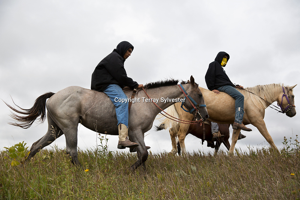 Opponents of the Dakota Access oil pipeline ride near the pipeline's route on the edge of the Standing Rock Sioux Reservation on September 9, 2016. Cannon Ball, North Dakota, United States.