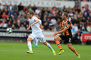 Gylfi Sigurdsson of Swansea city (l) gets away from David Meyler of Hull city. Premier league match, Swansea city v Hull city at the Liberty Stadium in Swansea, South Wales on Saturday 20th August 2016.<br /> pic by Andrew Orchard, Andrew Orchard sports photography.