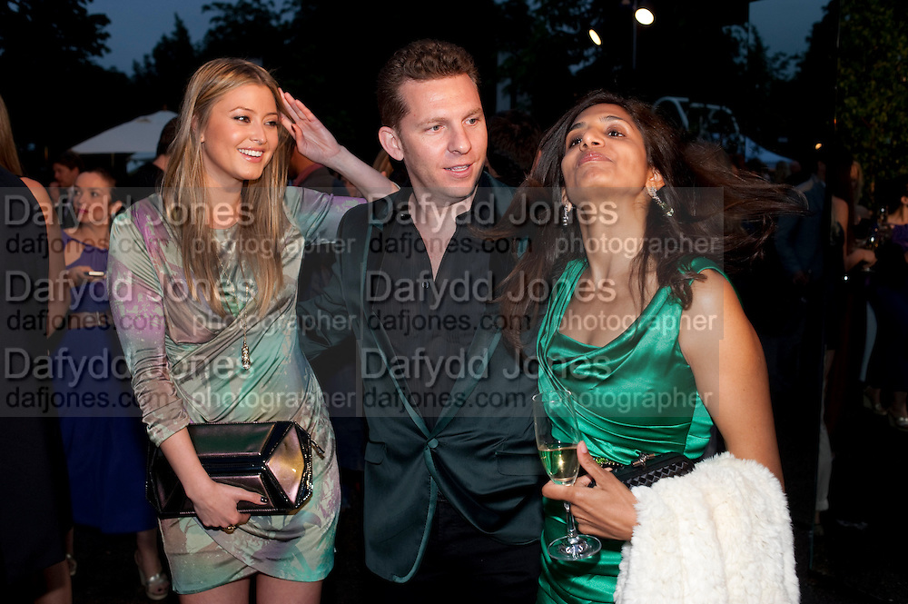 HOLLY VALANCE; NICK CANDY; DIVIA LALVANI, The Summer party 2011 co-hosted by Burberry. The Summer pavilion designed by Peter Zumthor. Serpentine Gallery. Kensington Gardens. London. 28 June 2011. <br /> <br />  , -DO NOT ARCHIVE-© Copyright Photograph by Dafydd Jones. 248 Clapham Rd. London SW9 0PZ. Tel 0207 820 0771. www.dafjones.com.