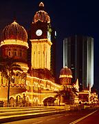 Sultan Abdul Samad Building illuminated at dusk, Meara Dayabumi Building beyond, Kuala Lumpur, Malaysia.