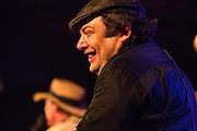 "Harmonica player ""Shaky"" Dave Pollack smiles as he takes a break."