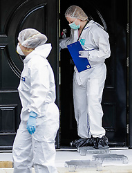 © London News Pictures. 21/05/2016. Weybridge, UK. Police forensics outside a property at St George's Hill, Weybridge, Surrey where the body of a woman in her 30's was discovered by paramedics this morning (Sat). Photo credit: Peter Macdiarmid/LNP