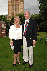 TV presenter JUDITH CHALMERS and her husband MR NEIL DURDEN-SMITH at the Lady Taverners Westminster Abbey Garden Party, The College Garden, Westminster Abbey, London SW1 on 10th July 2007.<br />