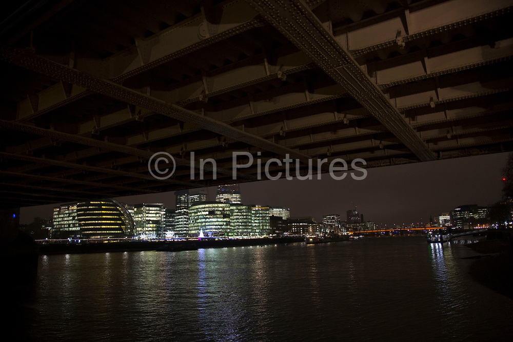 View at night looking towards More London and it's architecture from underneath the riveted structure of Tower Bridge in London, England, United Kingdom. (photo by Mike Kemp/In Pictures via Getty Images)