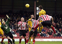 Picture: Henry Browne.<br /> Date: 26/12/2003.<br /> Brentford v Bristol City Nationwide League Division 2.<br /> Lee Peacock of City's header is cleared off the line in the first half.