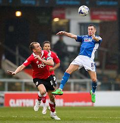 Oldham Athletic's Mike Jones rises for a header above Bristol City's Aaron Wilbraham  - Photo mandatory by-line: Matt McNulty/JMP - Mobile: 07966 386802 - 03/04/2015 - SPORT - Football - Oldham - Boundary Park - Oldham Athletic v Bristol City - Sky Bet League One