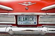 Red Chevrolet Impala convertible automobile registration plate, Anna Maria Island, Florida, USA