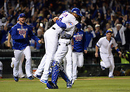 CHICAGO, IL - OCTOBER 22: Aroldis Chapman #54 and Willson Contreras #40 of the Chicago Cubs celebrate after the Cubs defeated the Los Angeles Dodgers in Game 6 of the NLCS at Wrigley Field on Saturday, October 22, 2016 in Chicago, Illinois. (Photo by Ron Vesely/MLB Photos via Getty Images)    *** Local Caption *** Javier Baez