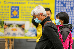 © Licensed to London News Pictures. 01/03/2020. London, UK. An Asian couple wearing surgical face masks in Chinatown as a precaution against new type coronavirus (COVID-19). Twelve more people have tested positive for coronavirus in the UK, bringing the total number of cases to 35. Photo credit: Dinendra Haria/LNP