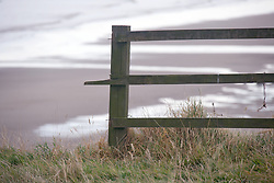 Brokenoff fence at eroded cliff edge at Mappleton; East Yorkshire; England