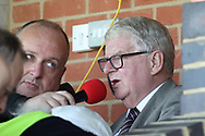 John Motson OBE doing some commentary during the EFL Sky Bet League 1 match between AFC Wimbledon and Oxford United at the Cherry Red Records Stadium, Kingston, England on 29 September 2018.