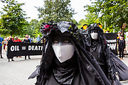 Oil Slick, black rebels demonstrate as part of the Extinction Rebellion 'Shell Out' protest on 8th September 2020 in London, United Kingdom. The environmental group gathered outside the Shell building to protest at the ongoing extraction of fossil fuels and the resulting environmental record. Extinction Rebellion is a climate change group started in 2018 and has gained a huge following of people committed to peaceful protests. These protests are highlighting that the government is not doing enough to avoid catastrophic climate change and to demand the government take radical action to save the planet. (photo by Andrew Aitchison / In Pictures via Getty Images)