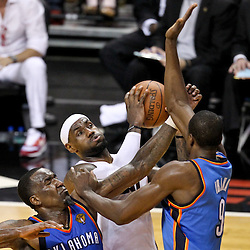 Jun 21, 2012; Miami, FL, USA; Miami Heat small forward LeBron James (6) shoots over Oklahoma City Thunder center Kendrick Perkins (5) and power forward Serge Ibaka (9) during the second quarter in game five in the 2012 NBA Finals at the American Airlines Arena. Mandatory Credit: Derick E. Hingle-US PRESSWIRE