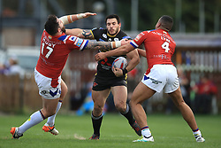 Wakefield's Craig Huby and Reece Lyne tackle Salford's Justin Carney during the Betfred Super League match at Belle Vue, Wakefield.