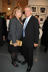 SIR NICHOLAS LLOYD and his wife EVE POLLARD at an exhibition of photographs commissioned by children's charity Barnardo's held at the Getty Images gallery, Eastcastle Street, London on 24th April 2008.<br /><br />NON EXCLUSIVE - WORLD RIGHTS