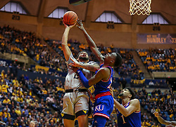 Jan 19, 2019; Morgantown, WV, USA; West Virginia Mountaineers forward Esa Ahmad (23) shoots during the second half against the Kansas Jayhawks at WVU Coliseum. Mandatory Credit: Ben Queen-USA TODAY Sports