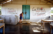 23 JULY 2002 - TRINIDAD, SANCTI SPIRITUS, CUBA: A woman on a state collective farm near the colonial city of Trinidad, province of Sancti Spiritus, Cuba, cleans the collective's dining hall July 23, 2002. Trinidad is one of the oldest cities in Cuba and was founded in 1514. .PHOTO BY JACK KURTZ