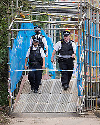 © Licensed to London News Pictures. 09/05/2021. London, UK. Police officers at the scene on the canal towpath at Old Oak Lane, near Harlesden, North West London, where the body of a baby was discovered in the water this afternoon. Photo credit: Ben Cawthra/LNP