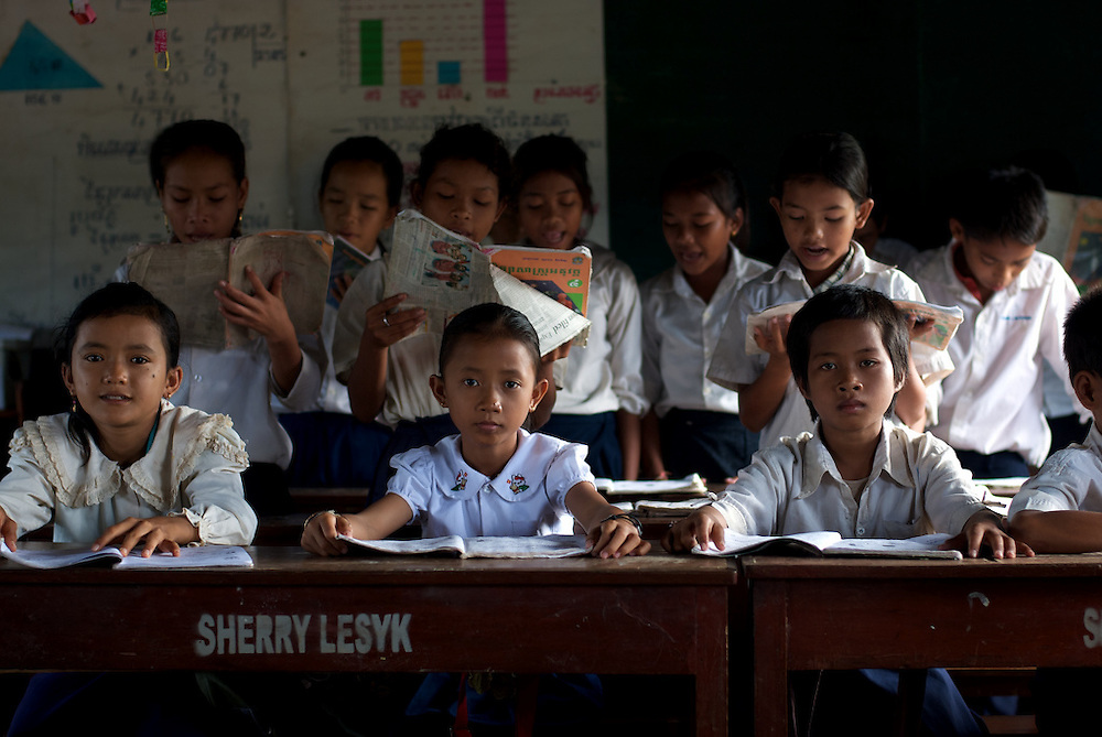 Fourth grade students read aloud from their schoolbooks in a primary school in the floating village of Chong Kneas, just outside of Siem Reap, Cambodia.