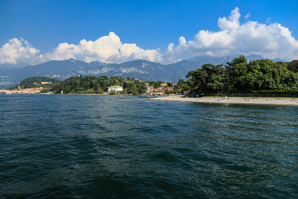 Swimmers enjoy the lake on San Giovanni beach on Lago di Como. There are no sand beaches on Lago di Como, but this pebbly beach in the neighborhood of San Giovanni of Bellagio has free entrance.
