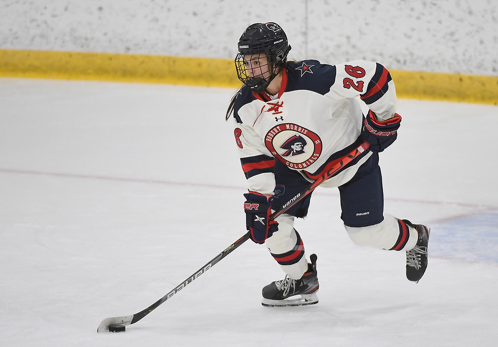 PITTSBURGH, PA - DECEMBER 03: Anna Fairman #26 of Robert Morris Colonials skates with the puck in the third period during the game against the Lindenwood Lions at Clearview Arena on December 3, 2020 in Pittsburgh, Pennsylvania. (Photo by Justin Berl/Robert Morris Athletics)