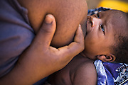 Child being breast fed by his mother. Northern Ghana, Thursday November 13, 2008.