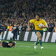 Digby Ioane beats the tackle of Mils Muliaina and races away to score a try for the Wallabies during the New Zealand V Australia Tri-Nations, Bledisloe Cup match at Eden Park, Auckland. New Zealand. 6th August 2011. Photo Tim Clayton