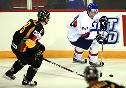 Tibor Melicharek of Slovakia (R) and Sebastian Osterloh of Germany at ice-hockey match Germany (played in old replika jerseys from year 1946) vs Slovakia at Preliminary Round (group C) of IIHF WC 2008 in Halifax, on May 05, 2008 in Metro Center, Halifax, Nova Scotia, Canada. Germany won 4:2. (Photo by Vid Ponikvar / Sportal Images)