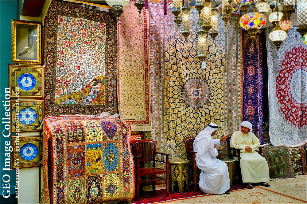 """Arab merchants talk in a carpet store in the Mall of the Emirates, opened in 2005 in what is now deemed """"New Dubai,"""" is one of the five largest shopping centers in the world. It covers about 2.4 million square feet of shops, a 14-screen multiplex cinema, the Ski Dubai indoor ski complex, a five- star Kempinski Hotel, and the Pullman Dubai Hotel."""
