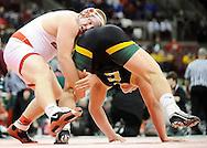 Nick Tavanello, left, of Wadsworth battles Garrett Gray of Oregon Clay in the third period of the 285-pound state championship match in Div. I. DAVID RICHARD / GAZETTE