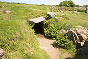 Entrance to underground fogue tunnel, Carn Euny prehistoric village, Cornwall, England, UK