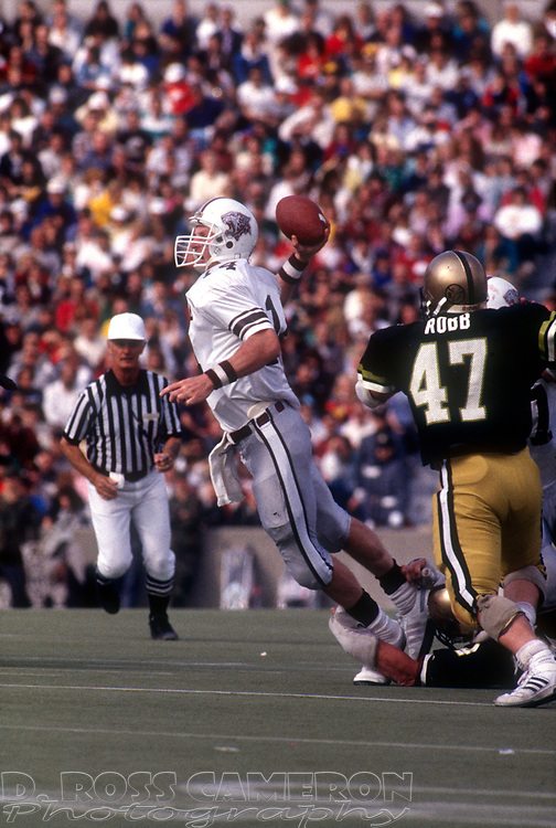 Lafayette quarterback Frank Baur (14) looks for an open receiver while scrambling away from defensive pressure by Army cornerback John Robb during an NCAA football game, Saturday, Oct. 15, 1988 at Michie Stadium in West Point, N.Y. Army won 24-17. (D. Ross Cameron/The Express)
